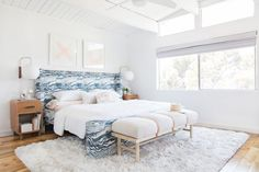 Put some pizzazz into every room.  This one is light and airy with the headboard being the big draw.