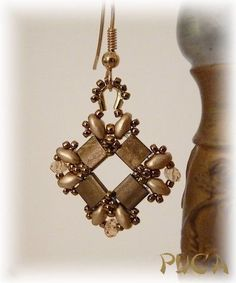"""Tila earring - no tute but notice how a wire guard is used and embellished to turn a component into an earring.  very clever.  #Seed #Bead #Tutorials"" by Shopway2much"