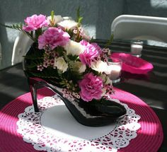 Shoe centerpieces: Maybe something to go on some of the wine tables, could be a total thumbs down, but maybe? Goodwill for shoes and I'm sure a little polish could fix them up