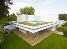 House S – Two Storey Bungalow with Green Rooftop Garden Designed by Roger Christ
