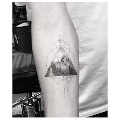 Fine line style mountain triangle tattoo on the right inner forearm. Tattoo artist: Dr. Woo