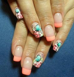 Enjoy this lush floral ensemble on your nails. The French manicure is with a light pink colored base and tipped with a thick salmon polish. The rest of the nails are artistically tipped in floral and butterfly designs with pink, white and sea green hues.