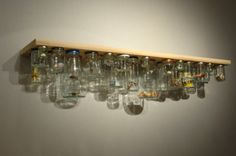 A collection of glass jam jars is screwed to the underside of a shelf, creating storage. The jars can be easily unscrewed and filled with new objects. Jam Jar Shelf was created for Perimeter Art and Design Galerie, Paris Craft Room Storage, Jar Storage, Storage Spaces, Storage Ideas, Storage Solutions, Creative Storage, Cupboard Storage, Shelf Ideas, Extra Storage