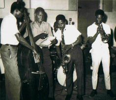 """Studio One recording session: LLOYD BREVETT, ROLAND ALPHONSO and JOHNNY """"DIZZY"""" MOORE from The Skatalites with legendary J.A. producer SEYMOUR """"COXSONE"""" DODD and drummer LLOYD KNIBS in the background."""