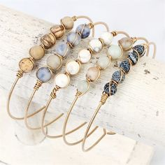 [orginial_title] – pin Wire Natural Stone Bracelet Wire Natural Stone Bracelet A simple yet eye-catching wired bracelet adorned with 5 beautiful earthy natural stones! Toggle closure makes it easy and comfortable for all-day wear. Bracelet Fil, Wire Wrapped Bracelet, Stone Bracelet, Beaded Jewelry, Beaded Bracelets, Hippie Jewelry, Men's Jewelry, Jewelry For Men, Embroidery Bracelets