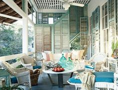 Repurposed shutters as a pourch/deck privacy wall. This is exactly (pretty much anyways) what I want!!!
