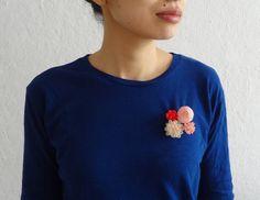 """MARIKO KUSUMOTO BROOCH  Polyester, thread  2"""" x 1.8"""" x 1.4"""""""