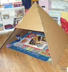 Tippytoe Crafts: Dramatic Play Pyramid from a big box! How fun and economical to build! Anyone can make this reading nook!