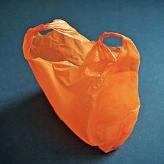 An orange plastic bag Orange Bag, Blue Orange, Orange Color, Orange Crush, Colour Colour, Blue Bg, Orange Zest, Blue Cream, Yellow