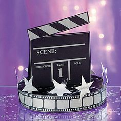 Save on our director's clapboard centerpiece and add a star-studded touch to tables.