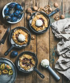 Plum and walnut crostata pie with ice-cream scoops in pans by 2enroute