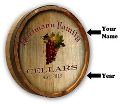 """Custom Grapes Color Quarter Barrel Sign. Authentic oak barrel head plaque, personalized for your wine-themed home bar with a """"family cellars"""" grape theme."""
