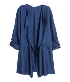Dark blue. Long jacket in a soft Tencel® lyocell blend with draped lapels, front pockets and long sleeves with a tab and press-stud. Unlined.