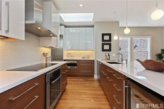 Wood cabinets on bottom and white cabinets on top (38 Camp St, San Francisco, CA)