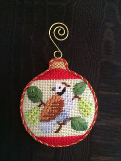 A swirling hook finishes this ornament elegantly! Stitch guide and hooks included with 12 Days Bauble Kit by Needlepoint.Com