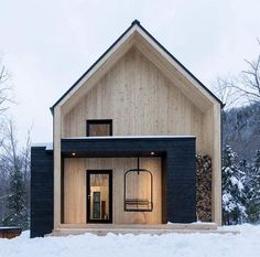 Winter Cabin ~ Feature wood store built into its facade! Designed by Canadian firm Cargo Architecture via Dezeen