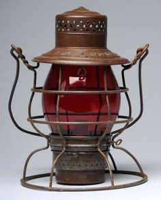"""Pennsylvania Railroad Lantern. Description With ruby red glass globe. Embossed """"PRR"""" on globe and marked """"Rayo"""" and """"39WB"""" on top. Condition (Excellent). Size 10"""" T."""