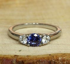 Natural Tanzanite and white Sapphire Trilogy ring available in white gold or titanium - engagement ring - wedding ring