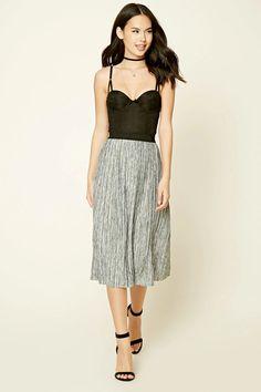 A crinkled woven midi skirt featuring an allover abstract print, raw-cut hem, and an elasticized waist.