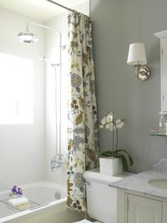 a great shower curtain is key in that upstairs bath because it is the first thing you see. Love the grey!