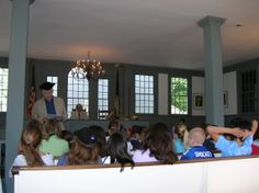Local Students at The Bedford Historical Society 1787 Court House.  History on the court house is shared and students participate in a mock trial