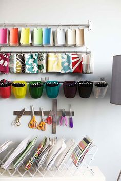 Organized swatches and a magnetic strip for tools in a craft studio / workspace