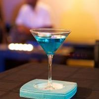 Unwind with These 14 Happy Hour Cocktails-this one is a  Smurf Martini Ingredients: 2 oz. gin 1/2 oz. blue Curacao