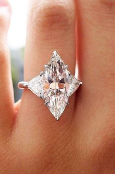 ✨✨✨ This is a SERIOUS ring! This carat marquise cut diamond ring with two carat trillion cut diamond side stones… Marquise Cut Diamond Ring, Diamond Cuts, Marquis Diamond Ring, Diamond Stone, Diamond Earrings, Perfect Engagement Ring, Rose Gold Engagement Ring, Marquise Engagement Rings, Trillion Engagement Ring