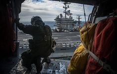 """An MH-60S  Sea Hawk helicopter to the """"Black Knights"""" of Helicopter Sea Combat Squadron (HSC) 4  prepares to land on the on the flight deck of the aircraft carrier USS George Washington (CVN 73)."""
