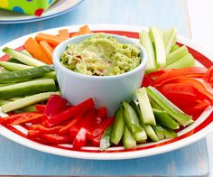 These Guacamole with Vegie Sticks make a delicious & healthy snack. For a healthy option offer the kids a rainbow fruit platter: strawberries for red, mango for orange, pineapple for yellow, kiwfruit for gree. Yummy Healthy Snacks, Yummy Food, Healthy Recipes, Healthy Eating, Rainbow Fruit Platters, Coles Recipe, Guacamole Recipe, Guacamole Dip, Cooking For A Crowd