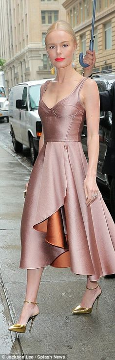 Fit like a glove: Created by designer Jason Wu, the dress featured a structured bodice which highlighted the star's slight frame before turning into a wrap-like skirt at the natural waistline