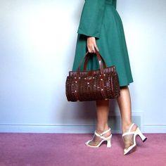 Woven Wicker Bag Vintage 50s 60s Dark Chocolate Straw Purse Basket Circular Handbag. $38.00, via Etsy.