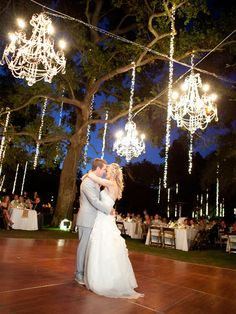 Breath taking outdoor wedding reception. 2012 and 2013 is seeing a large return of chandeliers and a massive incorporation of nature.