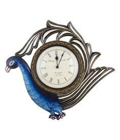 This Peacock shaped clock is Handpiainted in Blue , Yellow and Black andWill blend into light coloured walls.