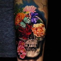Whats the symbolism behind the flower skull tattoo? I've seen some beautiful…