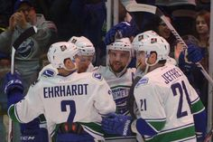 Utica Comets players surround Brandon DeFazio after DeFazio's first goal Saturday, Dec. 27 in a 6-3 American Hockey League win over Lake Erie at the Utica Memorial Auditorium. DeFazio scored three goals, his first professional hat trick, to help Utica to its seventh win in 10 games.