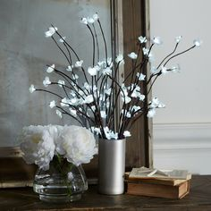 Lighted Floral Branches in a Vase - How to make a great metallic vase out of a dollar store glass one! Could even burn down some of the skinny worship candles then paint them using the method of the orchid vase from Alice Fake Flower Centerpieces, Faux Flower Arrangements, Vase Arrangements, Branches Allumées, Lighted Branches, Vase Crafts, Branch Decor, Flower Lights, Decorating With Pictures