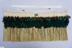 New Zealand flax, punamu is from the new river area of Marsden (shaped by a local Bay of Plenty carver) and peacock feathers. All hand made by a New Zealand con. New Zealand Flax, Flax Weaving, Maori Designs, Maori Art, New River, Peacock Feathers, Hanging Art, Contemporary Art, Art Pieces