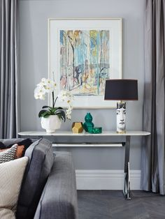 The first thing I noticed in this room was the painting then the lamp and the flower.