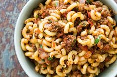 American comfort classic hamburger and macaroni! Browned ground beef cooked in a tomato onion sauce, mixed in with elbow macaroni.