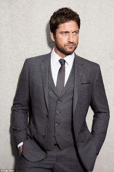 New face: Gerard Butler has taken over from Ryan Reynolds as the face of Hugo Boss colognes and looks suited and booted in the new campaign imagery.