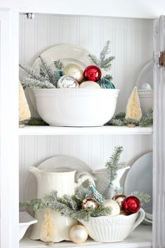 Who says you can't decorate around your kitchen utensils? Placing a bowl of ornaments w/ pine leaves is a great way to decorate your kitchen for Christmas!