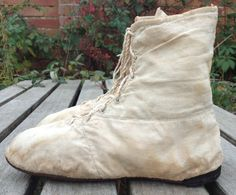 c1810 beige canvas boots. Front-lacing, straight-soled. They are made up of pieces of  canvas, as though to use every single scrap of fabric. Everyday boots, not fine ones. They are a bit like modern Converse boots!