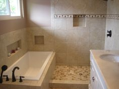 We decided to go with an open design for this light and airy bathroom. We love the way it came out!
