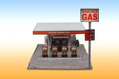 """""""Modern Gas Station"""" Photo Real Scale #Building Kit is a complete scale model gas station from the modern era that comes ready to trim and assemble. Based on the use of real building materials photographed and printed, each Scale Building Kit looks amazingly realistic! #scalebuilding #hobby #train #slotcar #DIY #diorama #realistic #gasstation #store"""