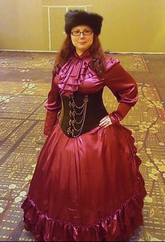 www.retroscopefashions.com Miss Brianne looking fantastic at Steamcon in our Burgundy Long Satin Bustle Skirt and matching Satin Cravat Ruffle Blouse.