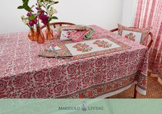 The classic Riyad design depicting elaborate flowers and vines stands out beautifully in the celebrated Indian color palette of pink and orange. A splendid floral border of marigolds makes for a striking finish.