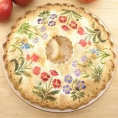 Anyone can do this- all it takes is an extra minute to apply cinnamon sugar or powdered food colors on your rolled out pie crust top then bake as usual. I absolutely LOVE this!