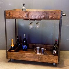 Reclaimed Industrial Bar Cart made from reclaimed Pallet wood, steel and black pipe with casters in a Red Oak finish.