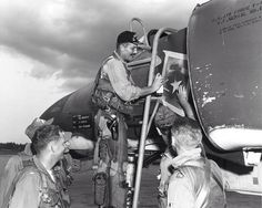 """Col. Robin Olds painting a victory star on the McDonnell F-4 """"Phantom"""" he was flying on May 4, 1967, when he shot down a MiG-21."""
